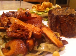 Pesto Pasta with Chanterelle's over the top drizzled with truffle oil and served with a Filet Mignon.