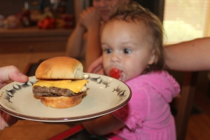 "Rule #1 everyone eats 5lbs of food.  Look at the baby looking at her hamburger.  She is thinking ""That is what I am talking about Dad""."