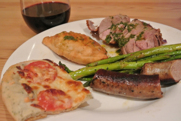 Lamb with Chimichuri sauce, empanada, focaccia pizza, aspargus with garlic truflle and sausage, and a Mendoza Red Malbec glass of wine.