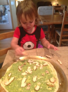 Here is my little monkey helping daddy with cooking.  She loves it.