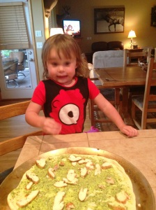 Monkey loving making pizza.