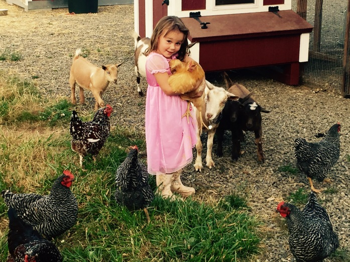 Mady and her chickens, she is holding her favorite....DUCKY.